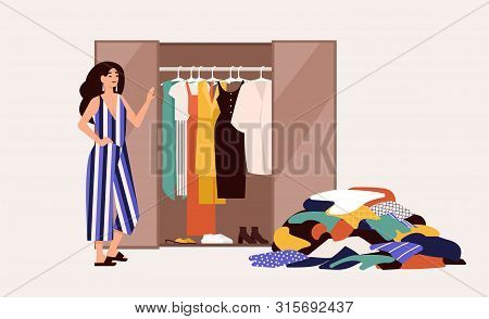 Cute Girl Standing In Front Of Opened Wardrobe With Apparel Hanging Inside And Pile Of Clothes On Fl