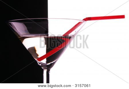 Cocktail Glass Close-Up With Red Sraw