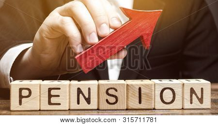 Wooden Blocks With The Word Pension And Up Arrow. Improving The Financial Condition Of Older People.