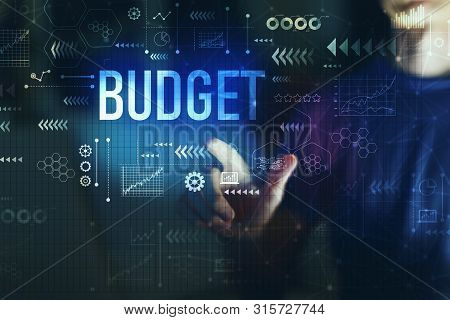 Budget With Young Man Touching Screen At Night