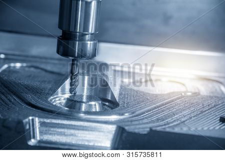 The Cnc Milling Machine Cutting The Forging Mould Part With Solid Radius Endmill Tool. The Mould And
