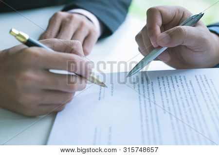 Business Team Partners Reading A Document Before Signing Contract Agreement Was Signed Co-investment