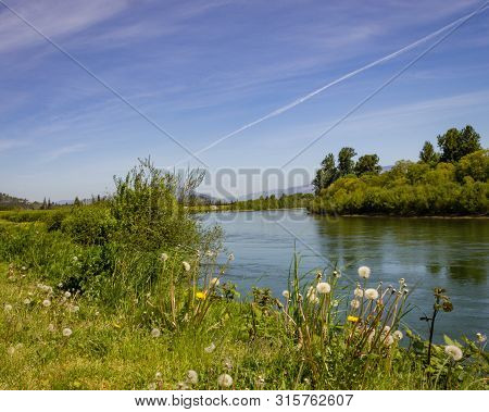 Summer Cloud Trails Over The Skagit River, In Burlington Washington