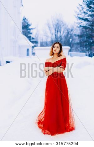 Beautiful Snow Maiden Girl With Red Hair On February Nature. Beautiful Redhead Retro Woman In Red Go