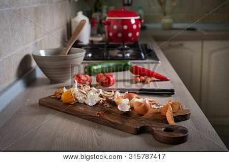 Food Leftovers On Chopping Board. Household Waste From Vegetable Ready To Compost. Environmentally R