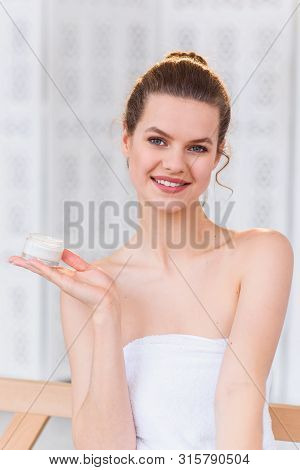 Woman Holds A Organic Natural Cream In Her Hand To Moisturize Her Skin And Wrinkle From Impurities.