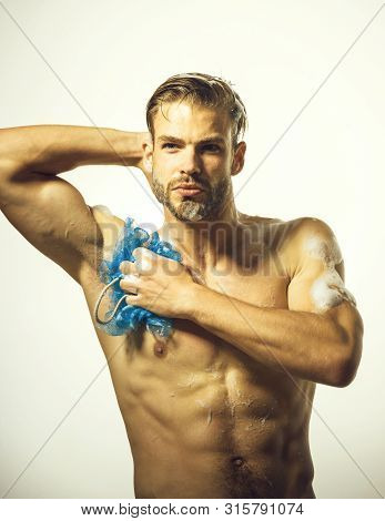 Handsome Muscular Man At Shower. Cosmetic For Men. Man Washing With Foam. Man Are Taking Shower In B