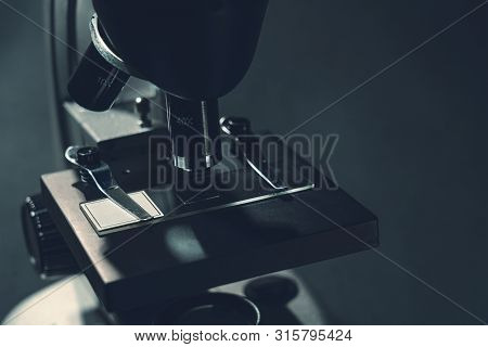 Details Of A Silver Microscope, With Black Background