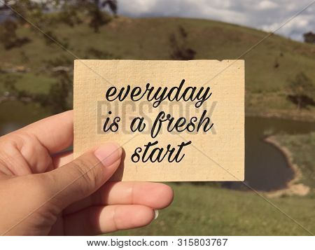 Motivational And Inspirational Wording - Everyday Is A Fresh Start Written On A Paper. Blurred Style