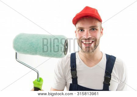 Renovation Service. Paint And Renovate. Decorator Painting Wall. Man Smiling Face In Cap Hold Paint
