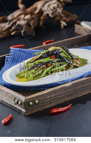 Stir-fried Eggplant Cowpea In A White Ceramic Dish