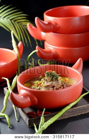 Braised Beef Tongue With Fresh Pepper In A Red Clay Pot
