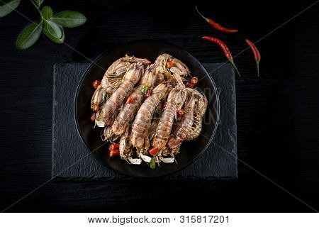 Mantis Shrimp In Pepper And Salt Shrimps In The Black Background