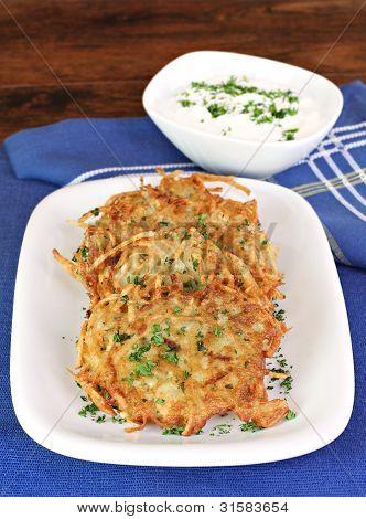 Potato Latkes And Sour Cream, Vertical.