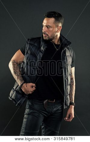 Tattoo Brutal Attribute. Man Brutal Unshaven Hispanic Appearance Tattooed Arms. Bearded Man Posing W