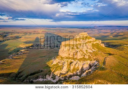 Jail Rock on Nebraska Panhandle - aerial view at summer sunrise with a long shadow