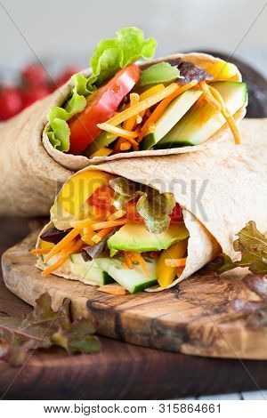 A Healthy Lunch Or Dinner Of A Vegan / Vegetarian Wrap Made With  Argula Lettuce, Sliced Tomatoes, C