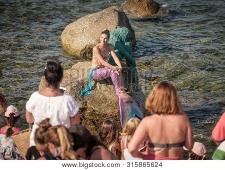 Ile Rousse, Corsica, France - 6th August 2019. Ingrid Fabulet, Miss Mermaid International 2016, Pose