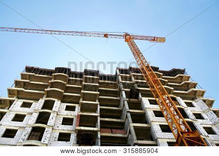 Construction Site Background. Work On The Construction Site. Hoisting Cranes And Building Activity.