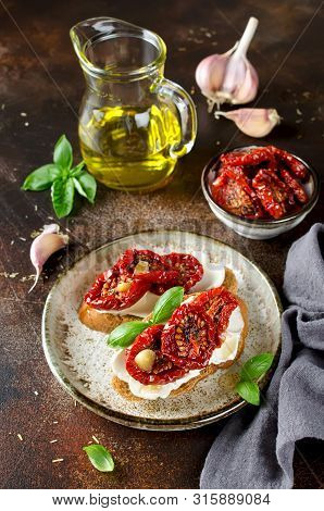 Bruschetta With Olive Oil, Sundried Tomatoes, Cottage Cheese And Fresh Basil. Tasty Savory Italian A