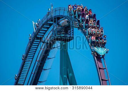 Orlando, Florida . July 29, 2019. People Enjoying Riding Mako Rollercoaster During Summer Vacation A