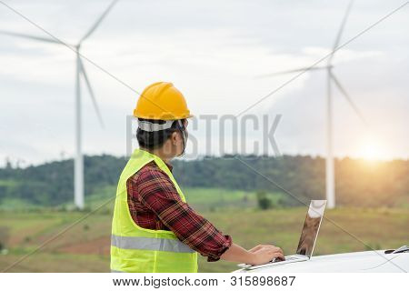 Engineering Working Outdoor At The Windmill Farm For Energy