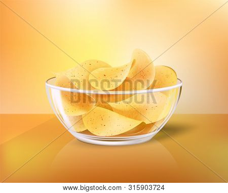 Crispy Chips In Glass Bowl As Snack To Beer. Fast Food Meal Made Of Fried Slices Of Potato In Heap I