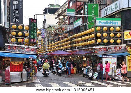 Keelung, Taiwan - November 22, 2018: People Visit Famous Miaokou Night Market In Daytime Keelung, Ta