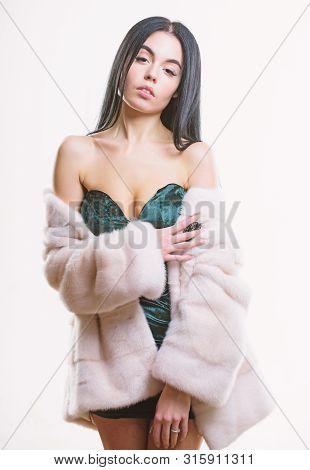 Girl Posing Fur Coat. Female With Makeup Wear Mink Beige Fur Coat. Woman Wear Velvet Sexy Dress And