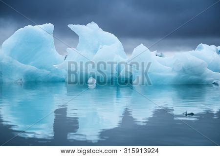 Icebergs In The Skaftafell National Park, Iceland. Ocean Bay And Icebergs. Reflection On The Water S