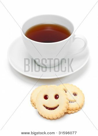 Cup Of Tea With Smiling Cookies