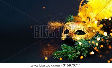 Masquerade Mask On Black Background With Confetti. New Years Decor. Blurred Effect. Close-up, Copy S