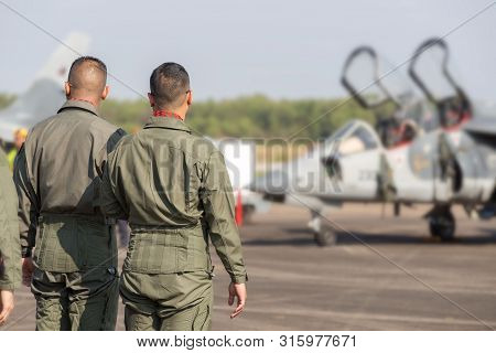 Pilots With A Jet Fighter, Pilots Who Are In Preparation For Flight Training On Military Airbase