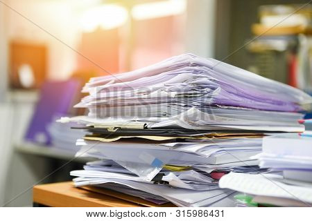 Lot Of Work Document File Working Stacks Of Paper Files Searching Information On Work Desk Office /