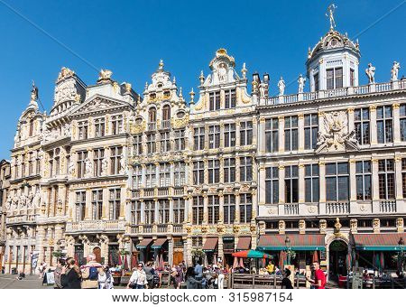 Brussels, Belgium - June 22, 2019: Beige Stone Facades And Gables With Statues On Top And Bar-restau