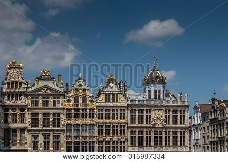 Brussels, Belgium - June 22, 2019: Beige Stone Facades And Gables With Statues On Top At Northwest S