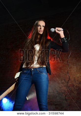 Young Beautiful Woman Singing On The Scene
