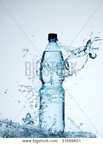 Bottles With Mineral Water And Splash Around It