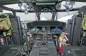 Cockpit of Sikorsky helicopter with plenty of switches inside poster