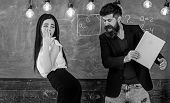 Man with beard slapping sexy student, chalkboard on background. Girl on helpless face punished by teacher. Schoolmaster punishes sexy student with slapping on her buttocks with book. Role game concep poster