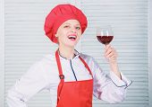 Exquisite dinner concept. Wine degustation. How to match wine and food like expert. Girl wear hat and apron enjoy aroma of drink. Woman chef hold glass of wine. Which wine to serve with dinner poster