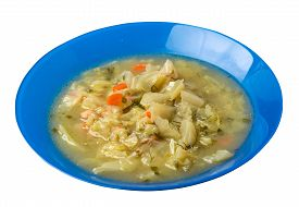 Cabbage Soup On A Blue Plate Isolated On White Background. Vegetarian Soup Soup. Healthy Food Top Si