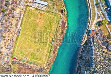 Obrovac. Soccer Field By Zrmanja River Aerial View. Karst Landscape Of Obrovac, Town In Dalmatia Reg