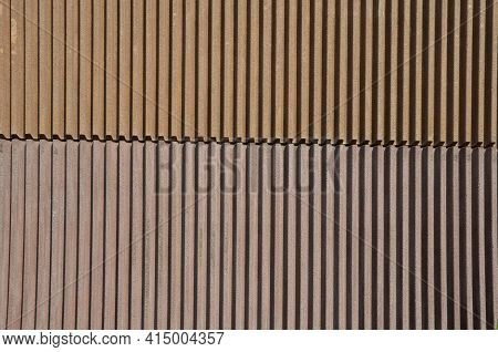 Soundproof Wall Made Of Concrete Porous Ribbed Material. Fence Of Brown Blocks Inserted Into Metal B