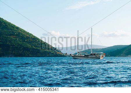 A Large Wooden Yacht With Two Masts Sails On The Bay Of Kotor.