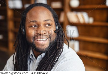 Close-up Of Mature Black African Man With Dreadlocks, Operator Of Call Center Or Business Leader. Sa