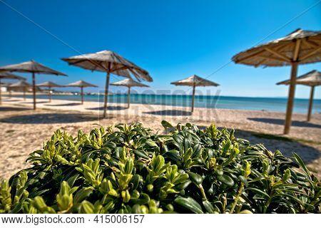 Pebble Beach And Umbrellas View, Island Of Vir, Dalmatia Region Of Croatia
