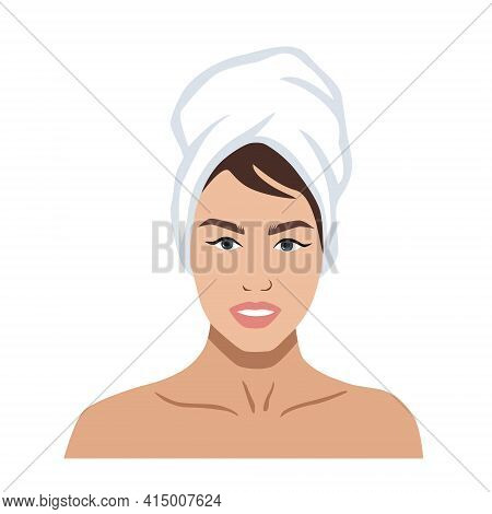 Portrait Of A Beautiful Woman With A Towel On Her Head. Skincare Or Spa Concept