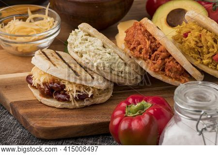 Delicious Arepas Wooden Board. High Quality And Resolution Beautiful Photo Concept