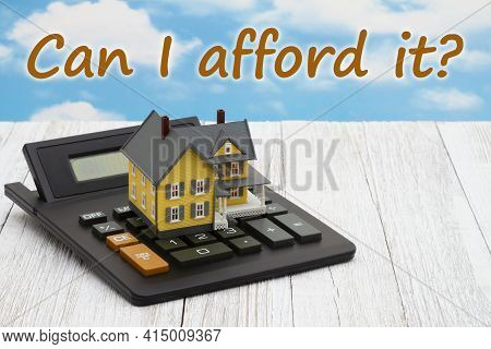 Can I Afford It Message With A Model House On A Calculator On Weathered Whitewash Wood With Clear Bl